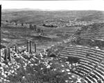 """A_377 - Jarash (April 1900) Jerash - the large theatre [S theatre (from left of cavea looking towards stage) Oval piazza behind theatre (Forum - ringed by colonnade of Ionic columns) and Jerash in background]"""
